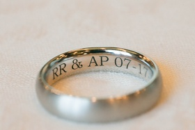 groom's wedding band engraved with initials and wedding date