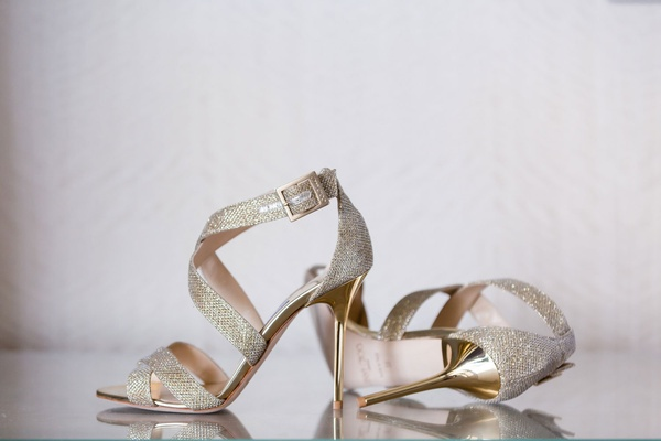 silver sandals with thick straps and shiny gold heels