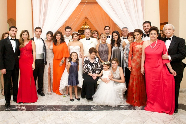 Francesca Miranda daughter Daniella Jassir wedding guests attendees friend family red orange gowns