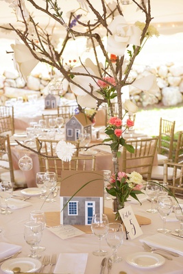 Wedding reception tent on Martha's Vineyard shingle style home and branch centerpiece rustic