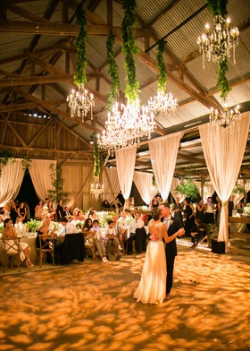Bride in keyhole back Jenny Packham wedding dress first dance in barn venue high ceilings wood beams