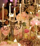 Candlesticks on candelabrum and pink peonies