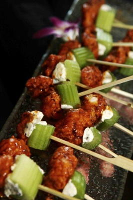 Spicy buffalo wing on skewer with bleu cheese and celery