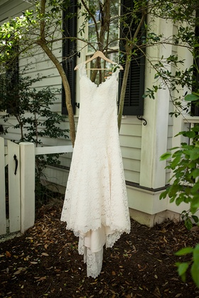 Bridal gown hanging on hanger outside in South Carolina lace cap sleeve low back Romona Keveza
