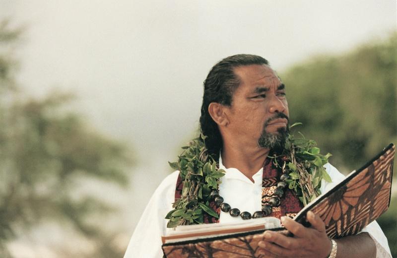 hawaii wedding officiant wearing leis