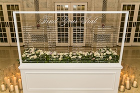 clear wedding sign seating chart white calligraphy candles in hurricane vases
