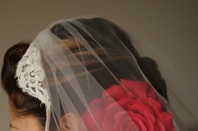 Bride's mantilla veil and red flower hair accessories
