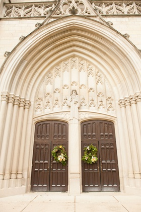 wedding ceremony venue in indiana presbyterian church arch tall brown wood doors wreaths