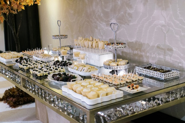 dessert table at 50th wedding anniversary reception on table with gold border and crystal details