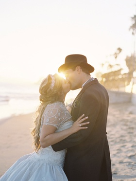 Bride and groom kiss couple portrait on beach in Santa Barbara, California