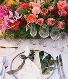 wedding reception tropical place setting protea rose orchid centerpiece palm under ribbon