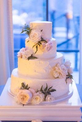 Wedding cake with fresh flowers buttercream frosting delicious cake simple four layer option