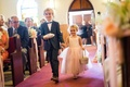 Flower girl and ring bearer holding hands as they walked down aisle at church in the Bahamas