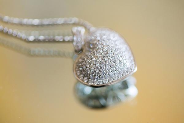 Silver locket necklace in shape of heart