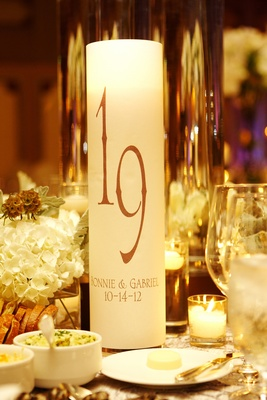 Cylinder candle holder with table number and wedding couple names