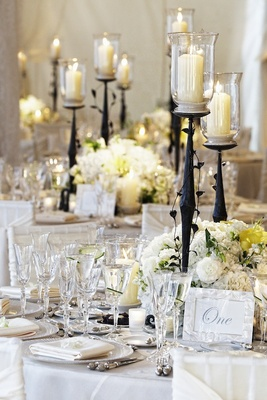 Classic white reception decorations with branch candleholder