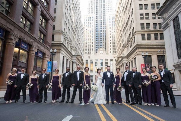 wedding party in street chicago downtown purple bridesmaid dresses tuxedos for groomsmen