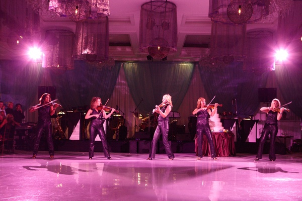 siren violinists from ken arlen orchestra perform at wedding