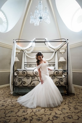 bride in tulle ruched monique lhuillier trumpet gown with added off-the-shoulder sleeves