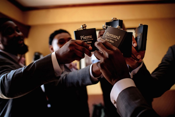 groomsmen toasting flasks while getting ready black flask with silver lettering best man personal