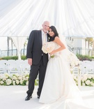 Bride and groom vow renewal tenth wedding anniversary party white tent blush ivory color palette