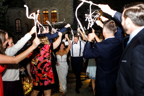 Wedding reception grand exit send off ribbon wands with bells guests waving send off