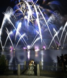 Bride and groom in front of Disney World fireworks