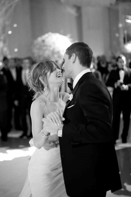 Black and white photo of couple dancing at wedding