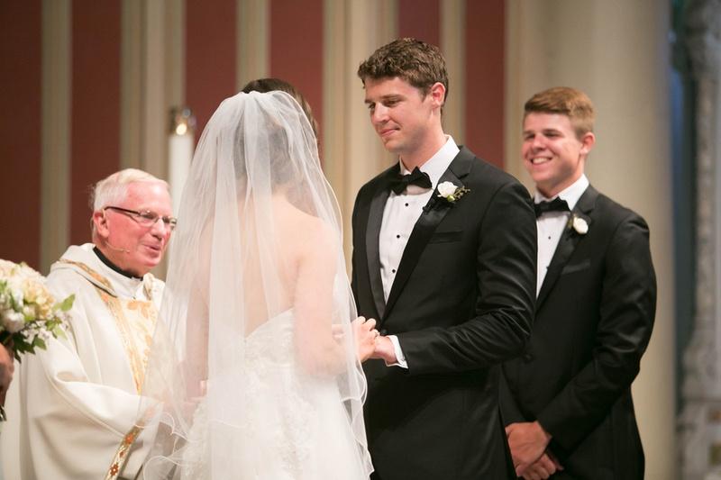 bride and groom recite vows at Catholic ceremony