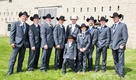 Ring bearer and groomsmen in cowboy hats and grey suits