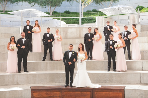 Newlyweds with bridesmaids and groomsmen outside