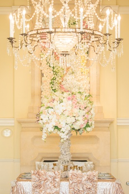 Wedding centerpiece and floral frame of pink, white, light orange roses, orchids, stargazer lilies