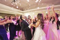 wedding guests tossing flower petals during first dance hotel ballroom