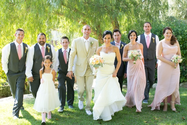 Bride and groom walking with bridesmaids and groomsmen