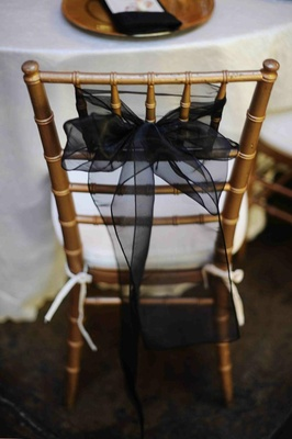 ... Gold Chair With White Cushion And Black Ribbon Decoration ...