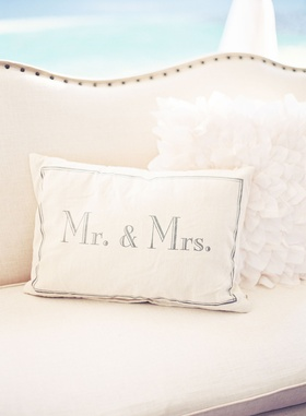 Wedding reception lounge area decorations pillow with mr and mrs written on it white fluffy pillow