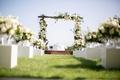 wooden chuppah white green florals seaside ceremony arrangements down aisle jewish wedding