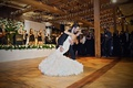 rustic wedding reception first dance the gold coast all stars twinkle lights wood beams