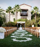 Spanish Colonial Revival hotel courtyard wedding with white palette