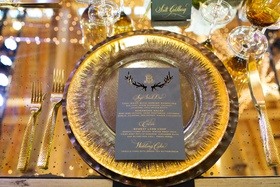 Gold forks and knife gold charger plate grey menu card with laser cut antler details and gold letter