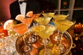 Martini glasses with colorful drinks and garnish