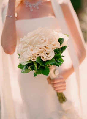 Bride holding monochromatic flowers