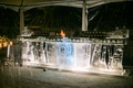 ice bar carved to look like tree trunks to serve moscow mule