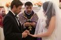 Wedding ceremony Armenian church traditional ring exchange with bride and groom
