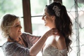 mother of the bride in silver mon cheri dress, mother of the bride helps bride get ready