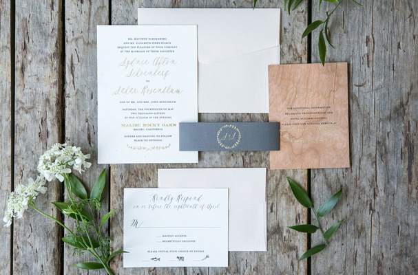 Wedding invitation with gold calligraphy grey belly band and wood grain card