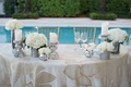 poolside wedding reception sweetheart table silver mercury glass vases white rose hydrangea gold