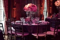 Ballroom wedding reception with pink and purple decorations