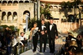 groom in tuxedo with mother of groom in one shoulder gown black mar a lago club