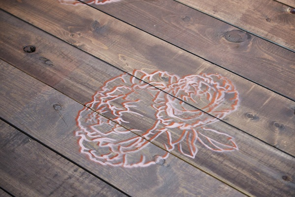 Wood plank ceremony aisle runner with hand painted flower
